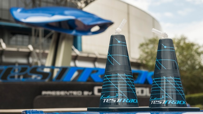 Cone-shaped beverage containers sitting in the sun outside of Test Track Presented by Chevrolet