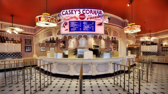 Indoor counter service at Casey's Corner featuring hot dogs and fries