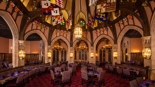Main dining hall at Cinderella's Royal Table, surrounded by archways
