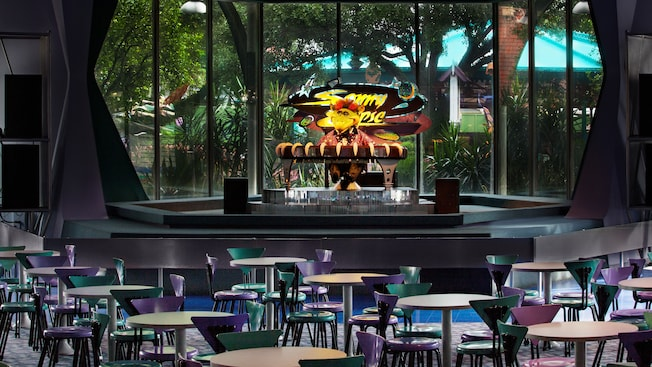 Indoor dining area with stage featuring Audio-Animatronics alien lounge-lizard singer Sonny Eclipse