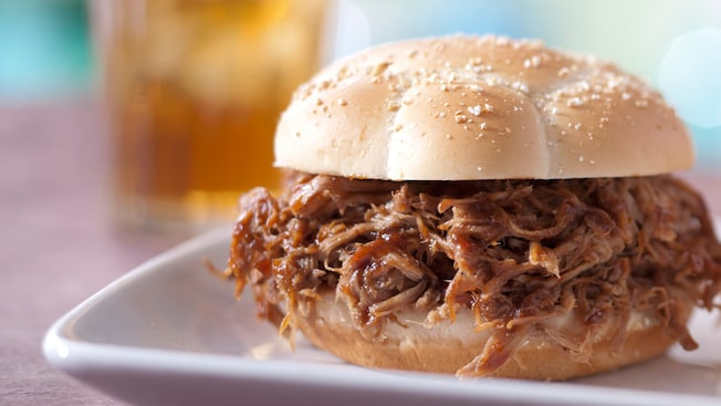 A barbecued pulled pork sandwich on a bun