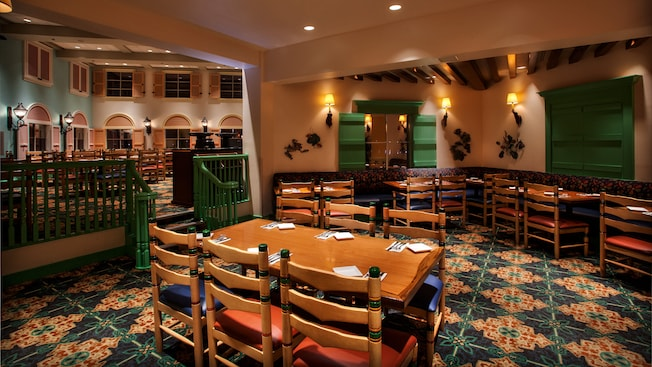Dining area with widows with colorful shutters at Shutters at Old Port Royale