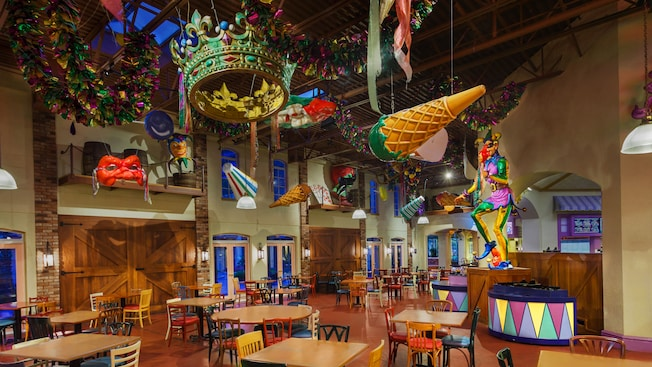 The food court for Sassagoula Floatworks and Food Factory decked out with balloons, jesters, streamers and other party paraphernalia