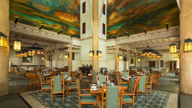 Oak furnishings, blond-wood beams, ironwork lanterns and scenic murals at Artist Point restaurant