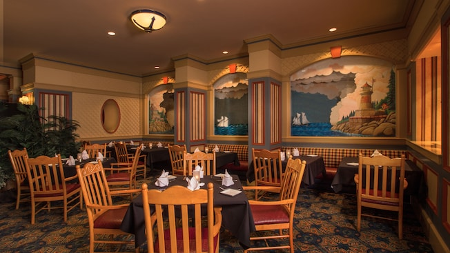 Tables at the back of Captain's Grille restaurant at Disney's Yacht Club Resort