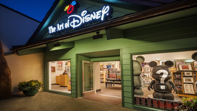 The Art of Disney window displays at Downtown Disney Marketplace, lit up at night
