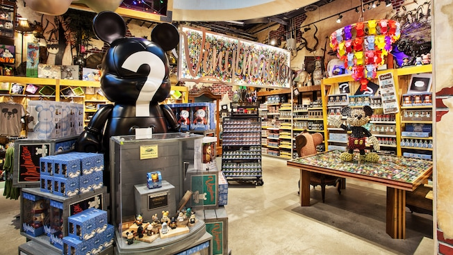 Disney collectibles on display inside D Street at Downtown Disney Marketplace