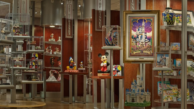 Collectibles on display inside The Art of Disney at Downtown Disney Marketplace