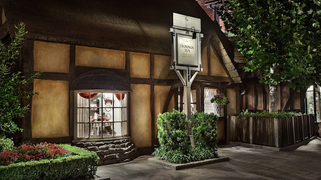 Exterior of The Tea Caddy shop in the United Kingdom Pavilion at night