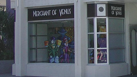 Stitch is featured in the window at the Merchant of Venus shop in Tomorrowland
