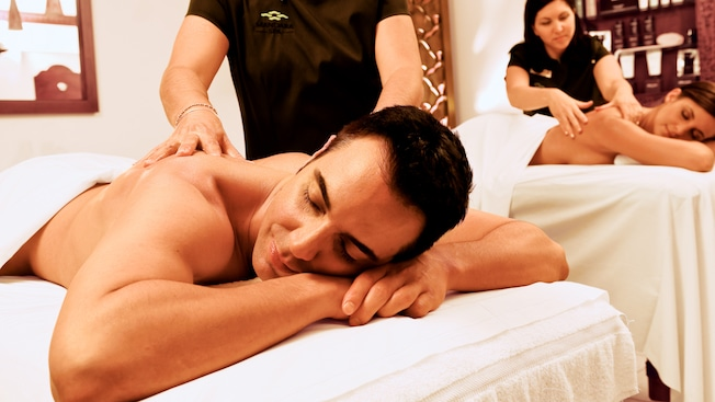 A man and woman getting table massages at the Mandara Spa