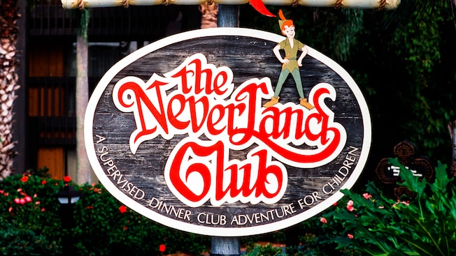 Sign reads 'The Never Land Club, a Supervised Dinner Club Adventure for Children'