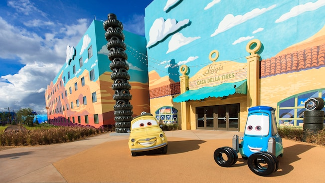 Life-sized Luigi and Guido from Disney•Pixar's Cars, parked outside the Cars Family Suites
