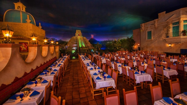 Dimly lit dining area with Mayan pyramid in background