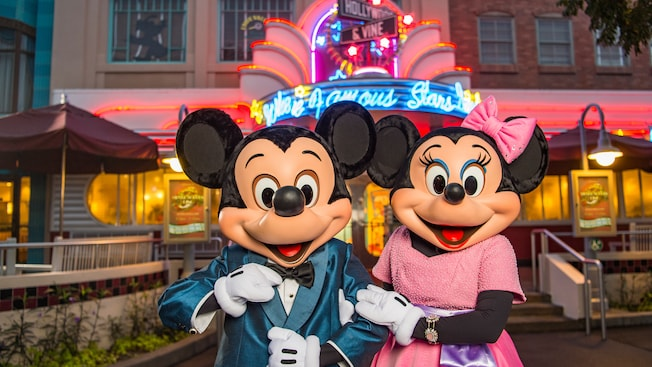 Minnie and Mickey, dressed to thrill, stand arm in arm outside the Hollywood & Vine marquee