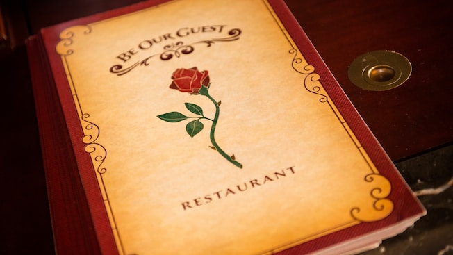 Close-up of the cover of a menu from Be Our Guest restaurant