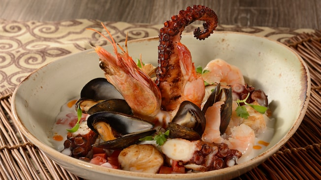 A stew with octopus tentacles, clams, mussels, tomatoes and shrimp