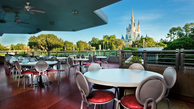 First-level covered outdoor dining area with a view of Cinderella Castle
