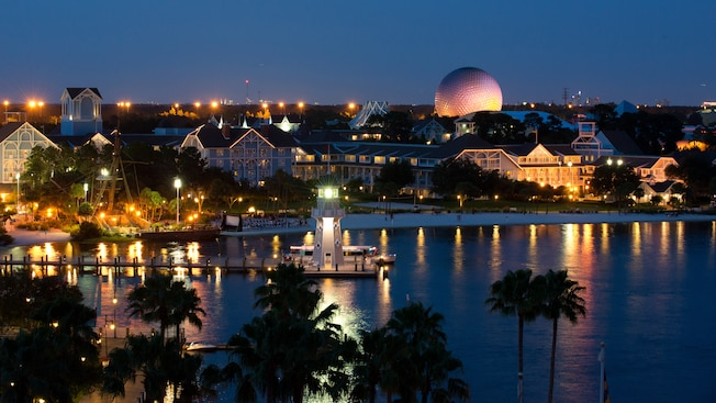 Panoramic view of Disney's Beach Club Resort and Crescent Lake , lit up at night