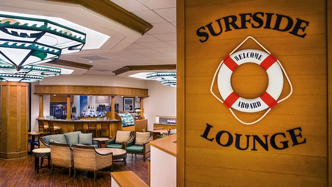 A sign inside Surfside Lounge is decorated with a life preserver on which are the words welcome aboard