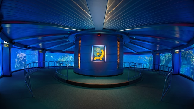 A circular room for 360° viewing of the sea life inside a huge aquarium in SeaBase at Epcot