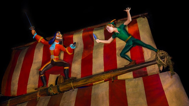 Peter Pan and Captain Hook sword fight on the mast of a magical pirate ship at Peter Pan's Flight