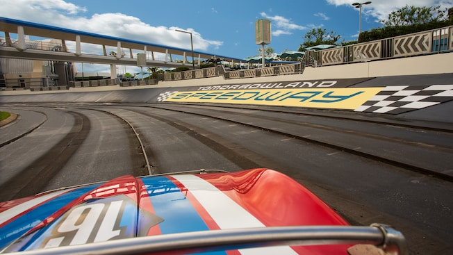 A car races around Tomorrowland Speedway