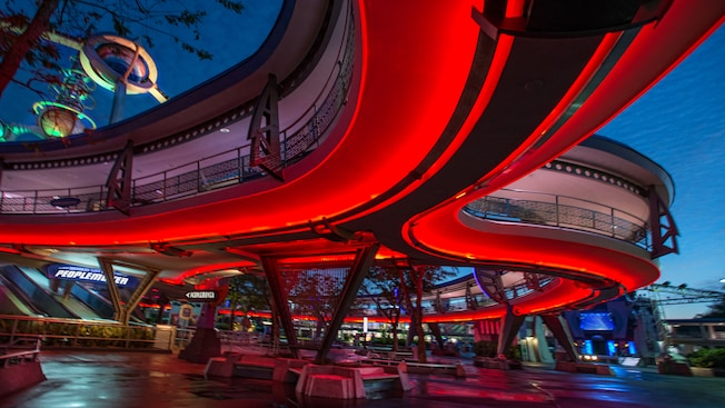 The courtyard below and entrance to Tomorrowland Transit Authority PeopleMover at night