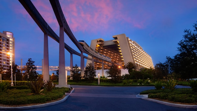The monorail entering the main concourse of Disney's Contemporary Resort at sunset