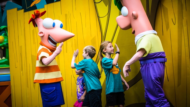 Phineas and Ferb high-five young Guests at Meet Phineas and Ferb near Streets of America