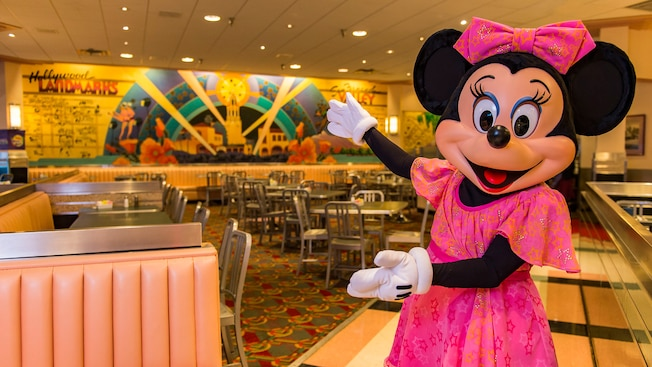 Minnie shows off the dining room of the Hollywood & Vine Restaurant