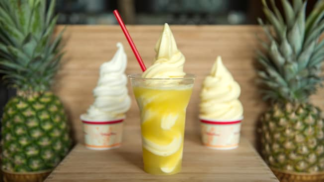 3 frozen treats from Aloha Isle snack shop, including a Pineapple float and 2 Dole Whips, with 2 pineapples.