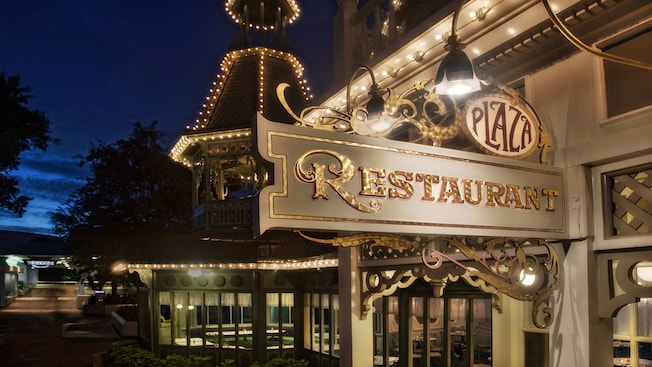 Front of The Plaza Restaurant trimmed in lights