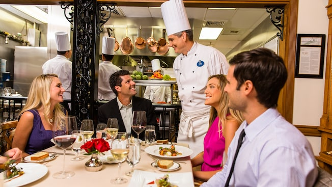 A Chef greets a table of Guests dining at Victoria and Albert's restaurant