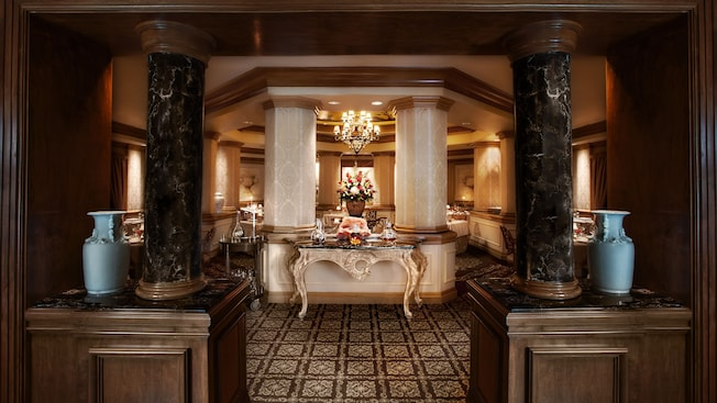 Dark marble columns frame the entrance to the octagonal dining area beyond