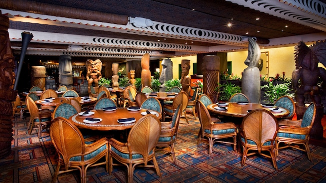 Dining room in a South Seas decor surrounded by tiki statues