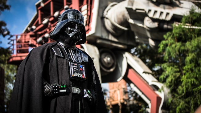 Darth Vader stands ominously in front of an AT-AT Walker in Disney's Hollywood Studios