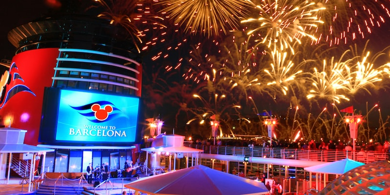 Fireworks light up the sky above the Disney Magic® Cruise Ship