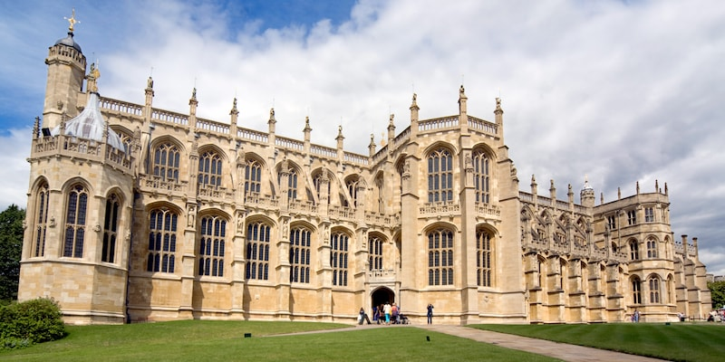 The entrance to the majestic Windsor Castle surrounded by manicured lawns