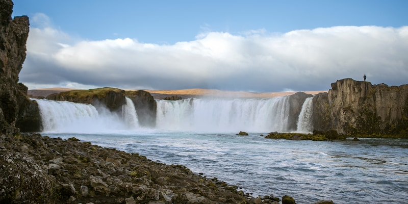 A picture of Goðafoss Waterfall taken from the banks of the water