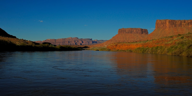 The Colorado River flowing past buttes and mesas