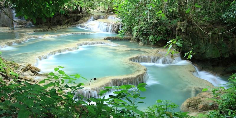A waterfall tumbles down a hillside