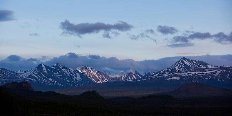 A scenic mountain range at twilight