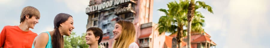 Four teens stand outside the Twilight Zone Tower of Terror at Disneys Hollywood Studios