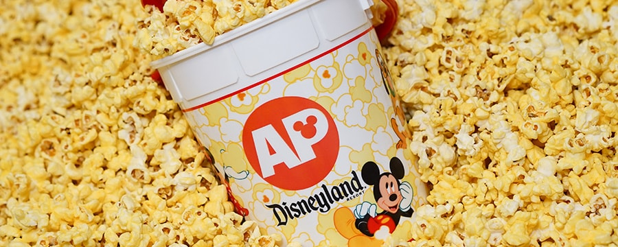 An Annual Passholder Refillable Popcorn Bucket surrounded by popcorn
