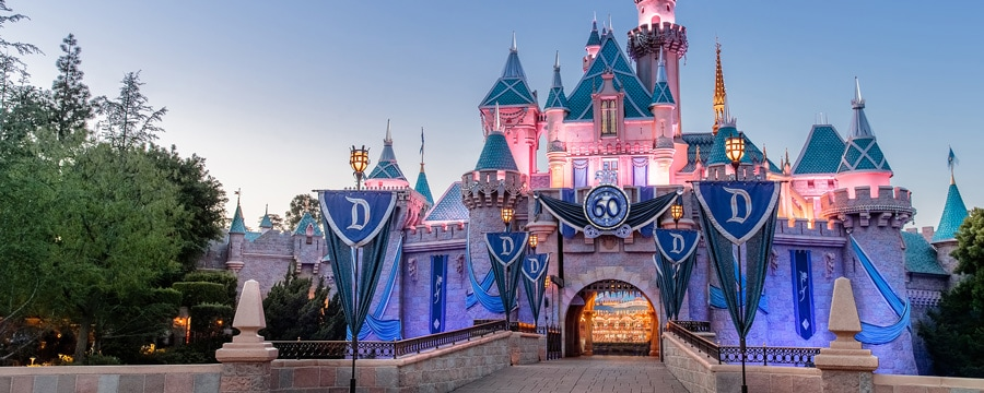 Sleeping Beauty Castle at Disneyland Park decorated for the 60th Diamond Celebration
