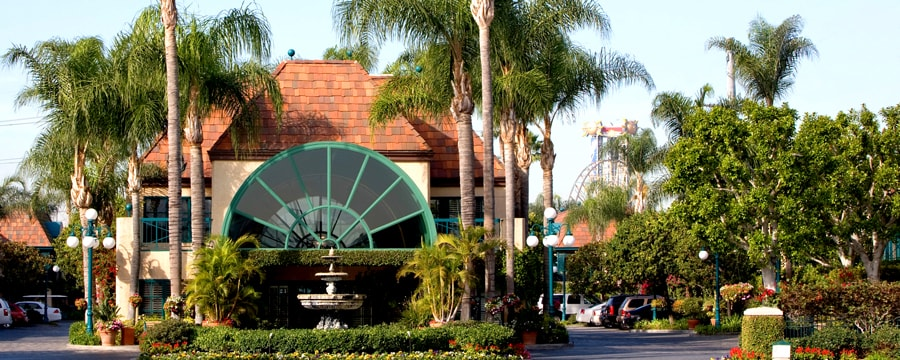 The main entrance to the classically styled Candy Cane Inn featuring a fountain and palm trees