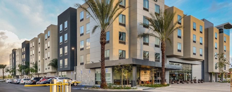Palm trees flank the entrance to the Homewood Suites hotel in Anaheim, California