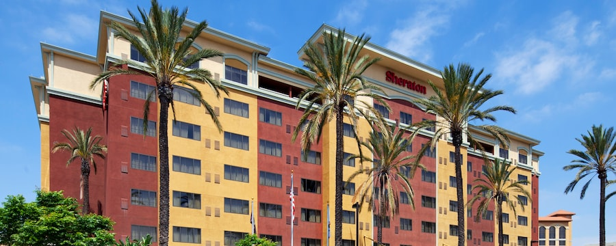 Palm trees stand in front of the entrance to the Sheraton Garden Grove in Anaheim, California