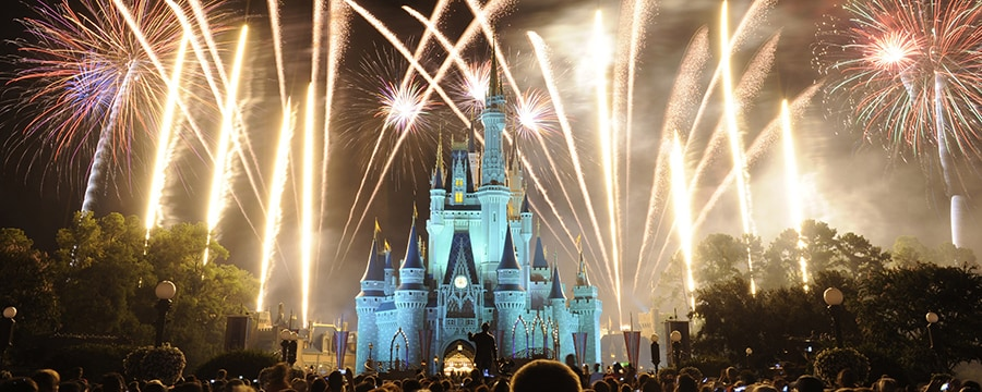 A spectacular showcase of fireworks ignites the sky around Cinderella Castle at Magic Kingdom park